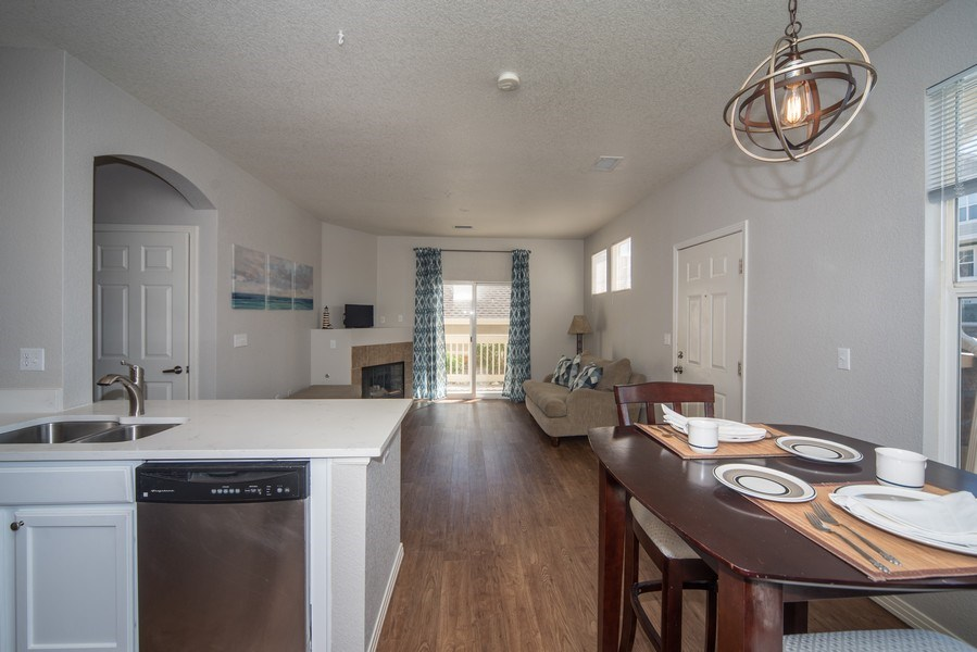 Real Estate Photography - 9527 Pearl Cir, Unit 102, Parker, CO, 80134 - Kitchen/Dining
