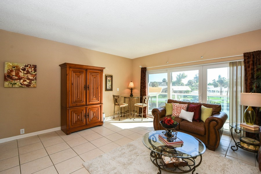 Real Estate Photography - 880 Mandalay Ave, Unit N104, Clearwater, FL, 33767 - Living Room