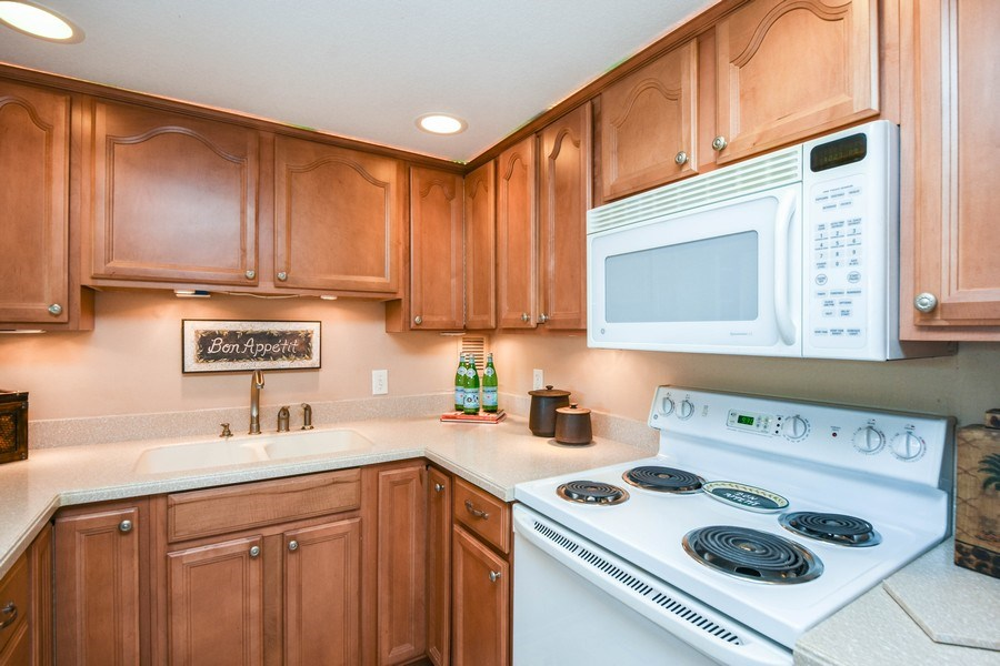 Real Estate Photography - 880 Mandalay Ave, Unit N104, Clearwater, FL, 33767 - Kitchen