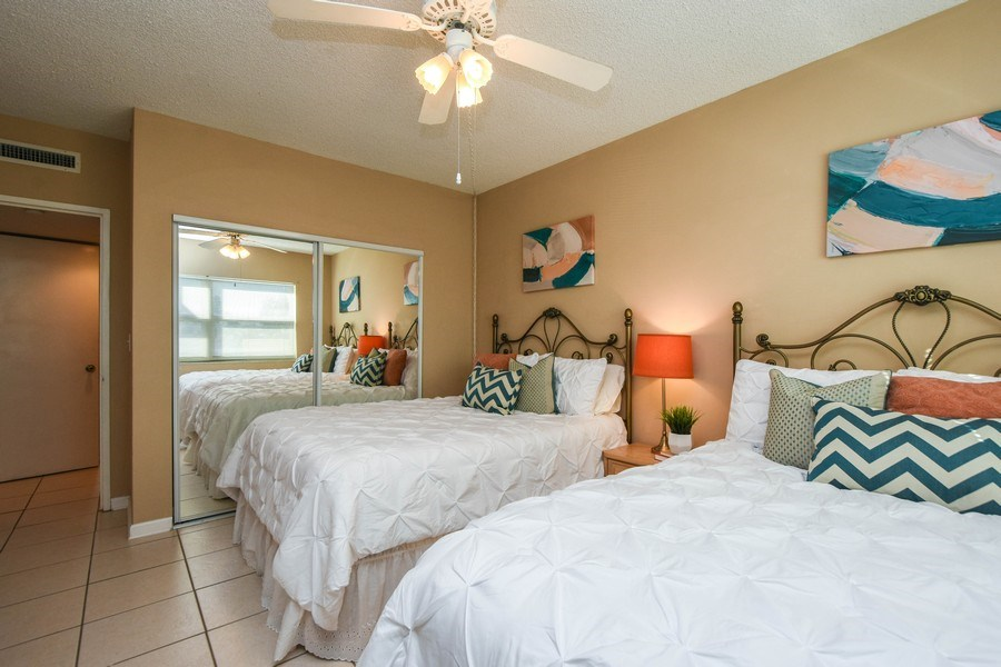 Real Estate Photography - 880 Mandalay Ave, Unit N104, Clearwater, FL, 33767 - Master Bedroom