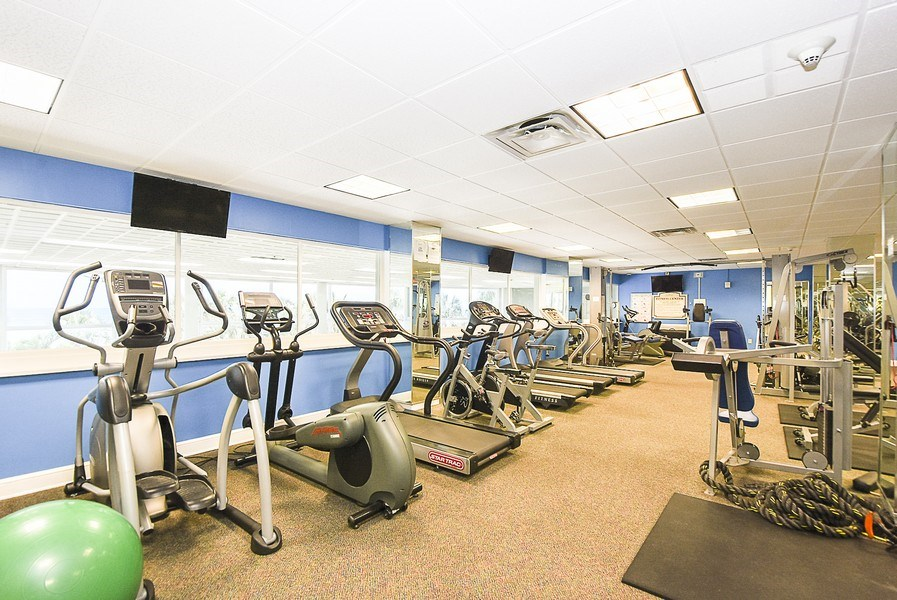 Real Estate Photography - 880 Mandalay Ave, Unit N104, Clearwater, FL, 33767 - Exercise Room