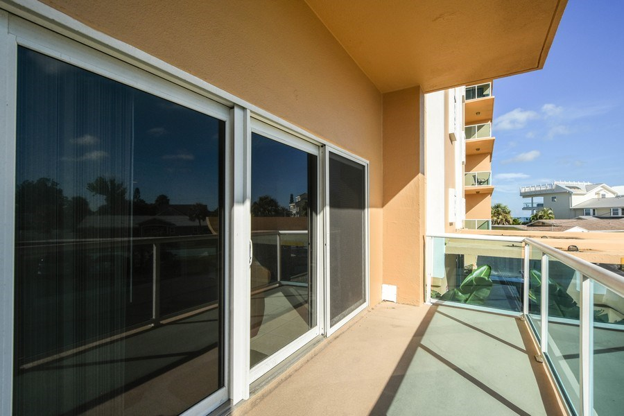 Real Estate Photography - 880 Mandalay Ave, Unit N104, Clearwater, FL, 33767 - Balcony