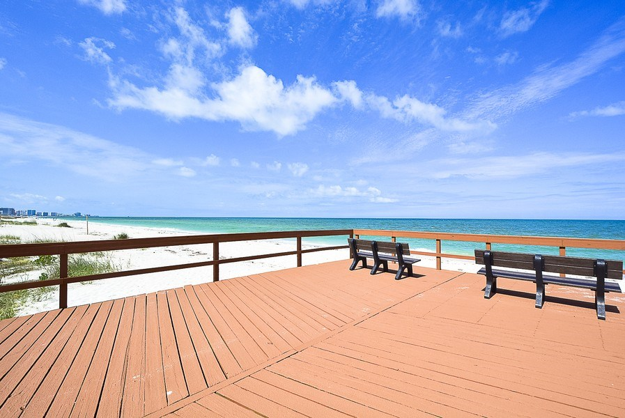 Real Estate Photography - 880 Mandalay Ave, Unit N104, Clearwater, FL, 33767 - Deck