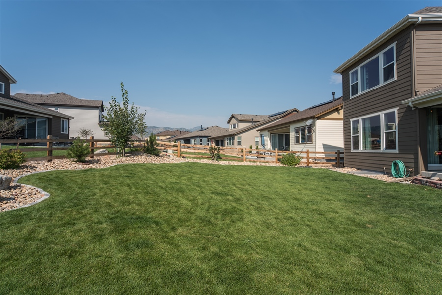 Real Estate Photography - 19612 W 95th Pl, Arvada, CO, 80007 - Fenced Back Yard with Mountain Views