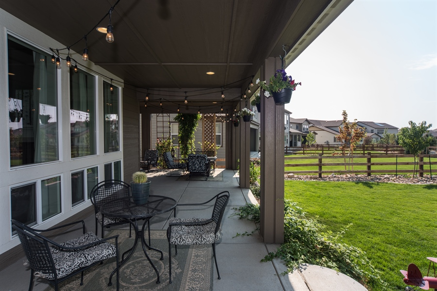 Real Estate Photography - 19612 W 95th Pl, Arvada, CO, 80007 - Enormous Wrap Around Patio