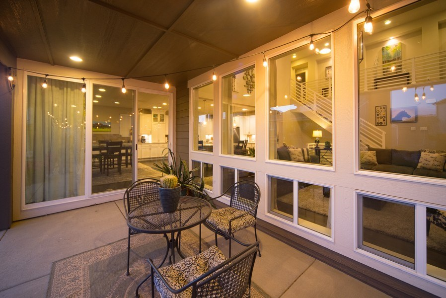 Real Estate Photography - 19612 W 95th Pl, Arvada, CO, 80007 - Walls of windows allow for indoor-outdoor living