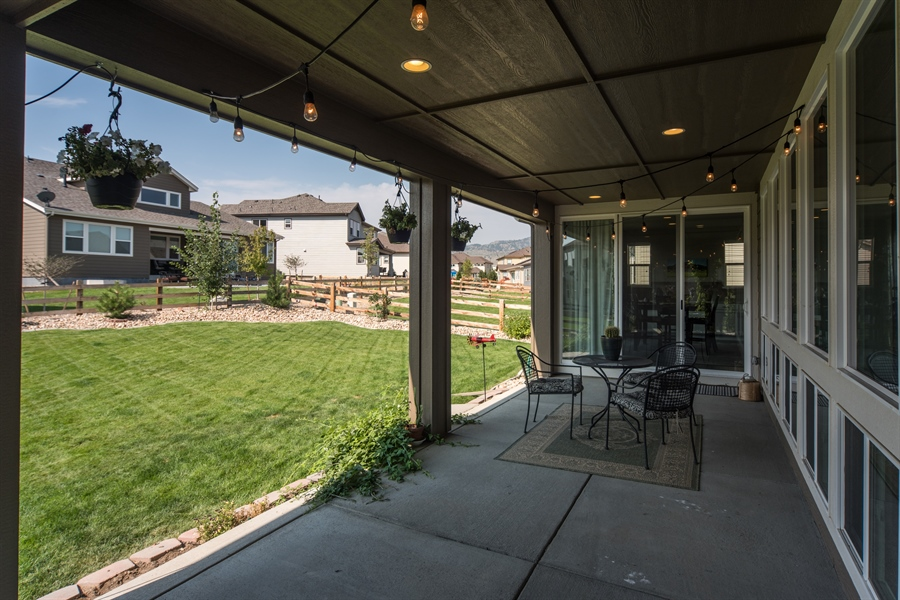 Real Estate Photography - 19612 W 95th Pl, Arvada, CO, 80007 - Extended Back Patio
