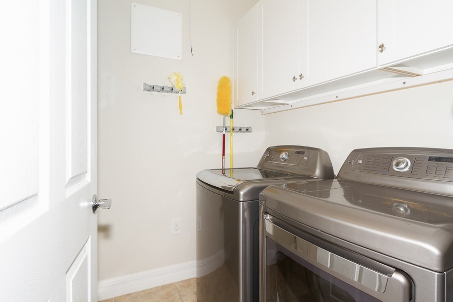 Real Estate Photography - 8180 Chianti Lane, Naples, FL, 34114 - Laundry Room
