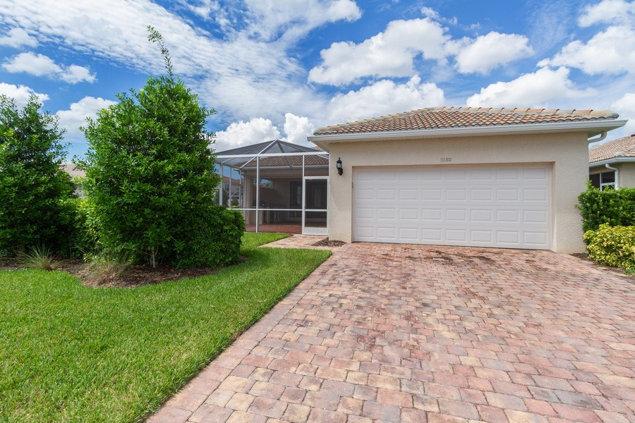 Real Estate Photography - 8180 Chianti Lane, Naples, FL, 34114 - Rear View