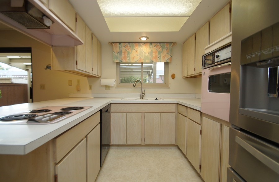 Real Estate Photography - 9085 E Nassau Ave, Denver, CO, 80237 - Kitchen