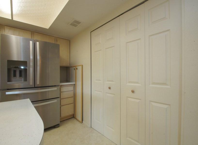 Real Estate Photography - 9085 E Nassau Ave, Denver, CO, 80237 - Laundry Room
