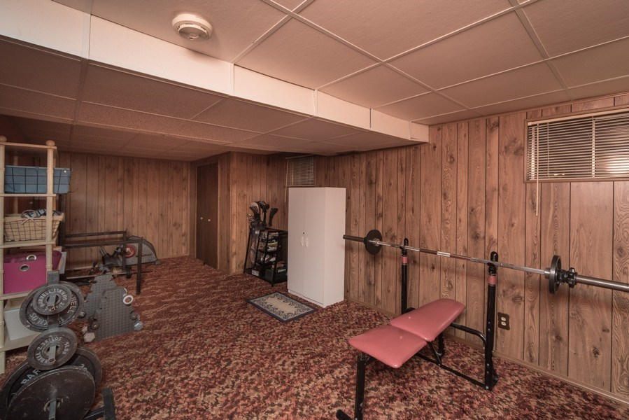 Real Estate Photography - 7069 Coors Ct, Arvada, CO, 80004 - Basement room used as exercise room!