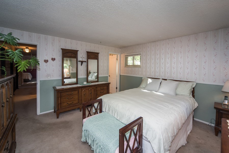 Real Estate Photography - 7069 Coors Ct, Arvada, CO, 80004 - Master bedroom with private bathroom & walk in clo
