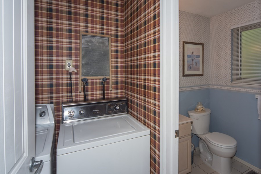 Real Estate Photography - 7069 Coors Ct, Arvada, CO, 80004 - View of Laundry and powder room from family room