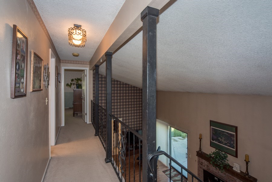 Real Estate Photography - 7069 Coors Ct, Arvada, CO, 80004 - Upper hallway to bedrooms