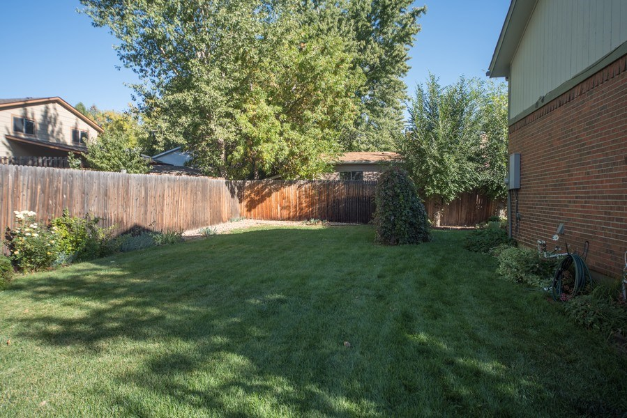 Real Estate Photography - 7069 Coors Ct, Arvada, CO, 80004 - Beautiful landscaped yard