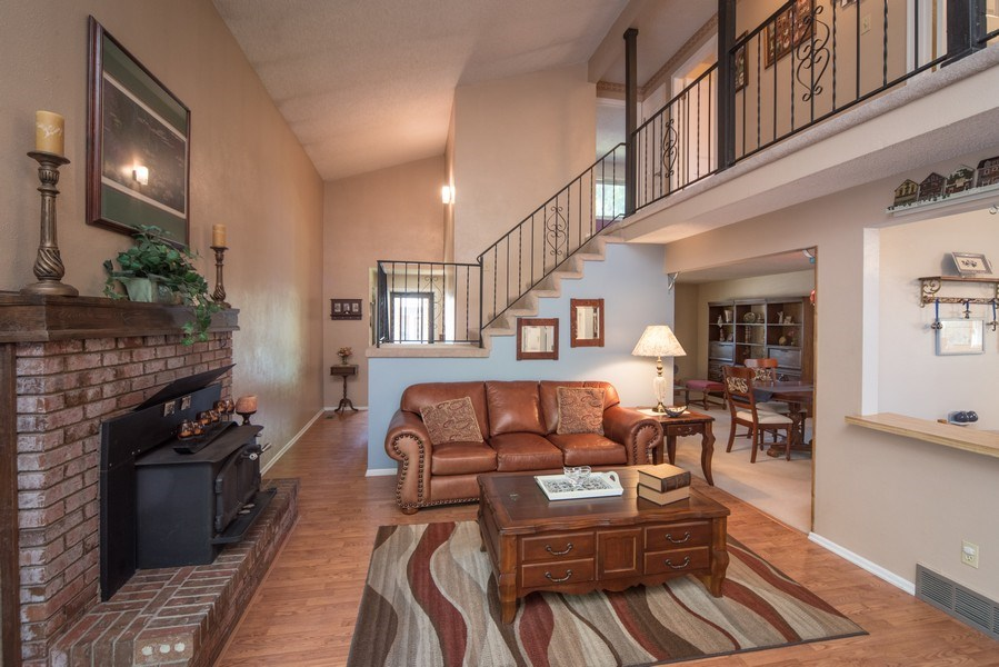 Real Estate Photography - 7069 Coors Ct, Arvada, CO, 80004 - Family room with wood burning fireplace