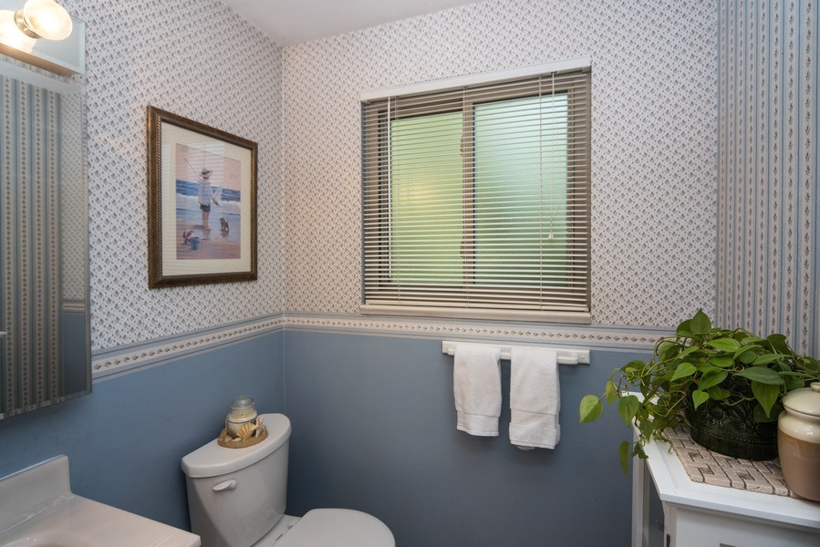 Real Estate Photography - 7069 Coors Ct, Arvada, CO, 80004 - Powder room on main floor