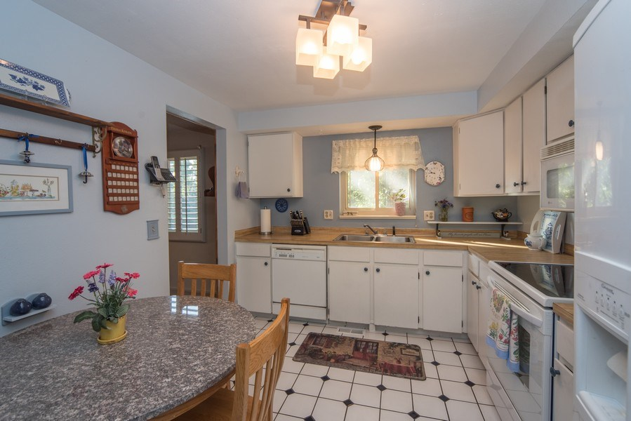 Real Estate Photography - 7069 Coors Ct, Arvada, CO, 80004 - Cheerful kitchen with tile floors!