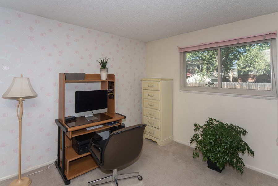 Real Estate Photography - 7069 Coors Ct, Arvada, CO, 80004 - Convenient main level bedroom or office