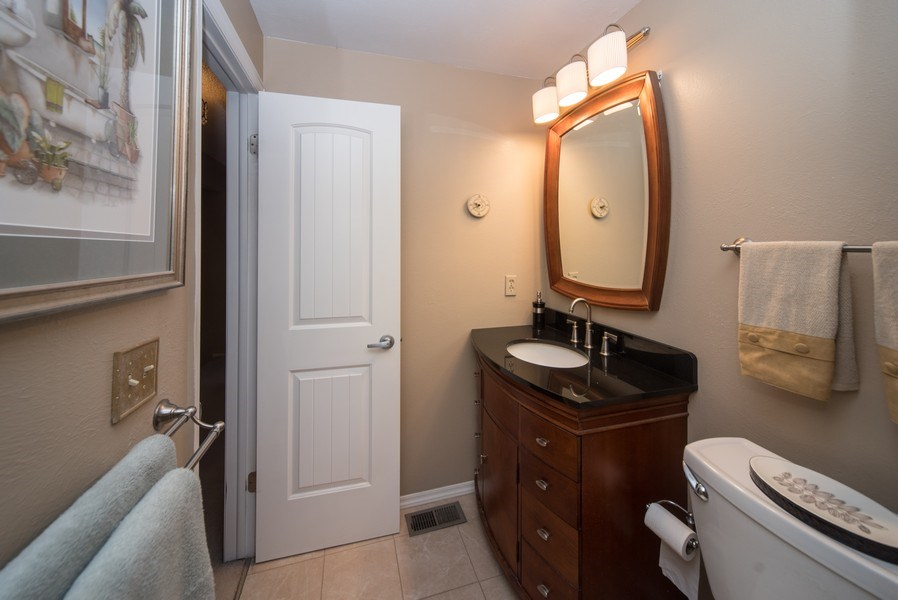 Real Estate Photography - 7069 Coors Ct, Arvada, CO, 80004 - Upper hallway bathroom