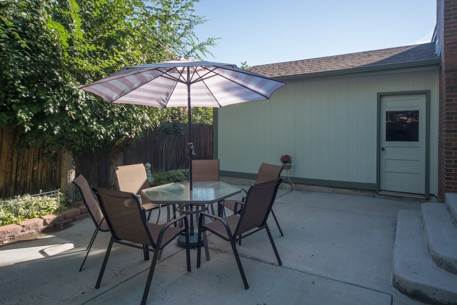 Real Estate Photography - 7069 Coors Ct, Arvada, CO, 80004 - Extended patio for outdoor dining