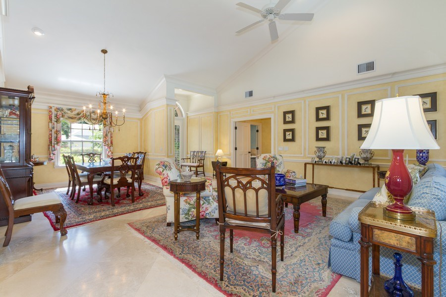 Real Estate Photography - 713 Pinecreek, Naples, FL, 34108 - Living Room / Dining Room