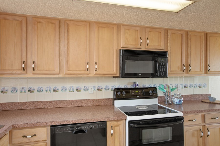 Real Estate Photography - 2730 Ocean Shore Blvd, Unit 107, Ormond Beach, FL, 32176 - Kitchen