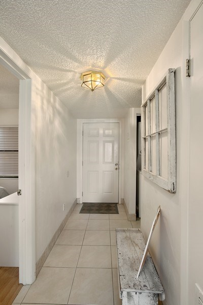Real Estate Photography - 2730 Ocean Shore Blvd, Unit 107, Ormond Beach, FL, 32176 - Entryway