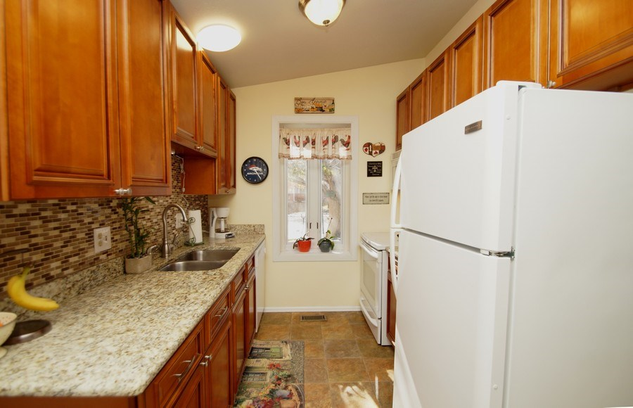 Real Estate Photography - 4852 S. Pagosa Way, Aurora, CO, 80015 - Kitchen