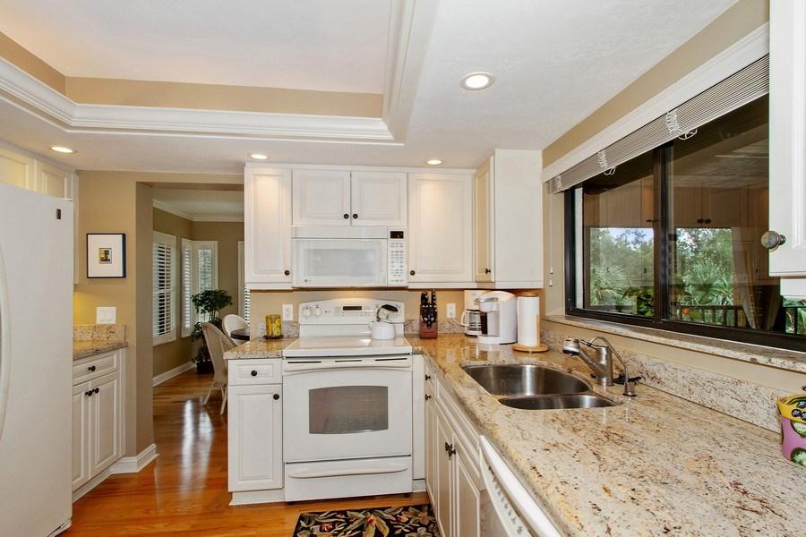 Real Estate Photography - 6710 Pelican Bay Blvd, Unit 435, Naples, FL, 34108 - Kitchen