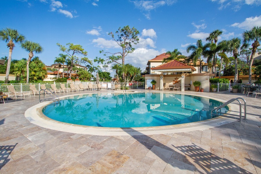 Real Estate Photography - 6710 Pelican Bay Blvd, Unit 435, Naples, FL, 34108 - Outdoor Pool