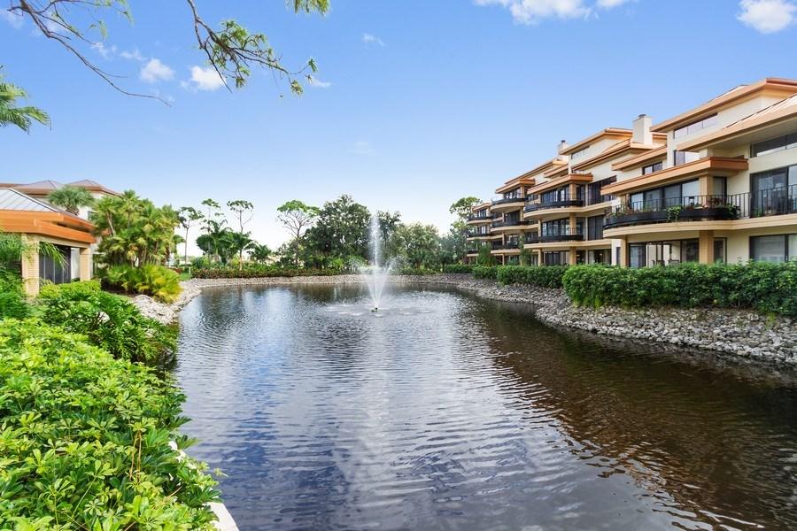 Real Estate Photography - 6710 Pelican Bay Blvd, Unit 435, Naples, FL, 34108 - Lake