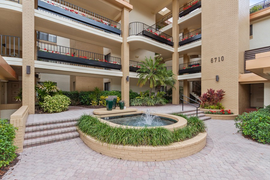 Real Estate Photography - 6710 Pelican Bay Blvd, Unit 435, Naples, FL, 34108 - Front View