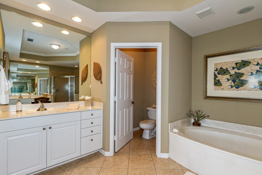 Real Estate Photography - 1615 Winding Oaks Way #201, Naples, FL, 34109 - Master Bathroom