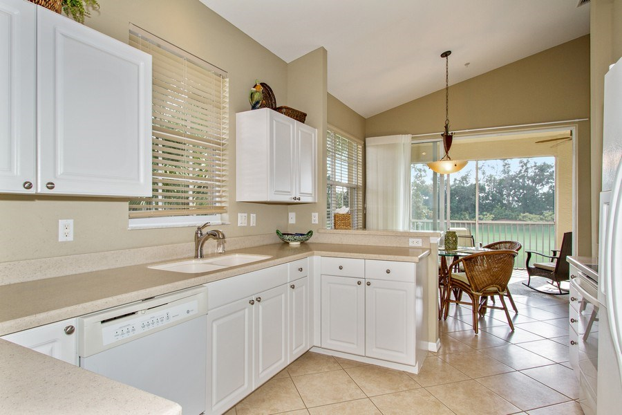 Real Estate Photography - 1615 Winding Oaks Way #201, Naples, FL, 34109 - Kitchen