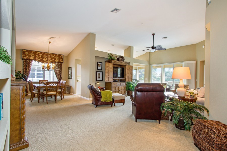 Real Estate Photography - 1615 Winding Oaks Way #201, Naples, FL, 34109 - Living Room / Dining Room