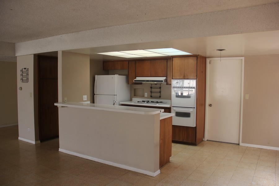 Real Estate Photography - 5051 Dartmouth Ave, Westminster, CA, 92683 - Kitchen with Breakfast nook to the right.