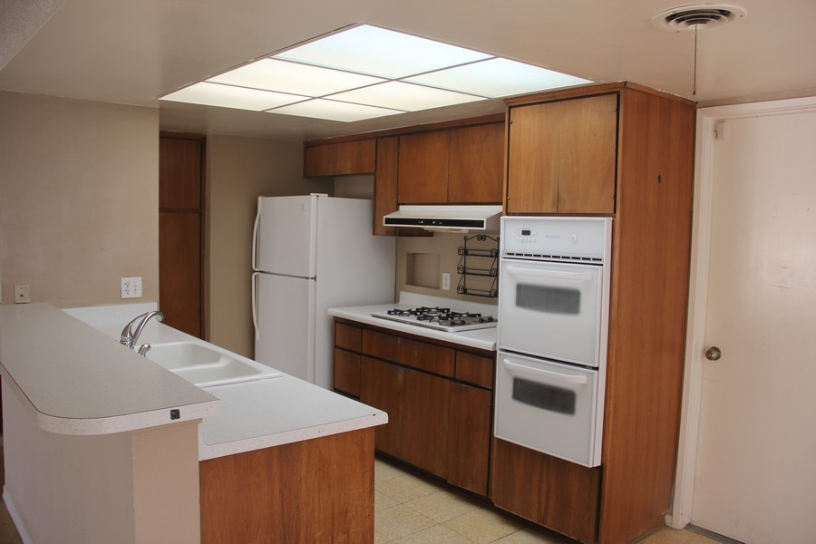 Real Estate Photography - 5051 Dartmouth Ave, Westminster, CA, 92683 - Open Kitchen with real wood cabinets