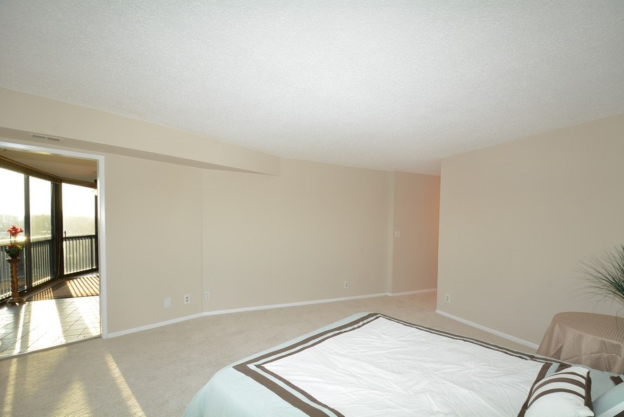 Real Estate Photography - 5904 Mount Eagle Dr, Unit 814, Alexandria, VA, 22303 - Master bedroom suite w/ access to balcony and two