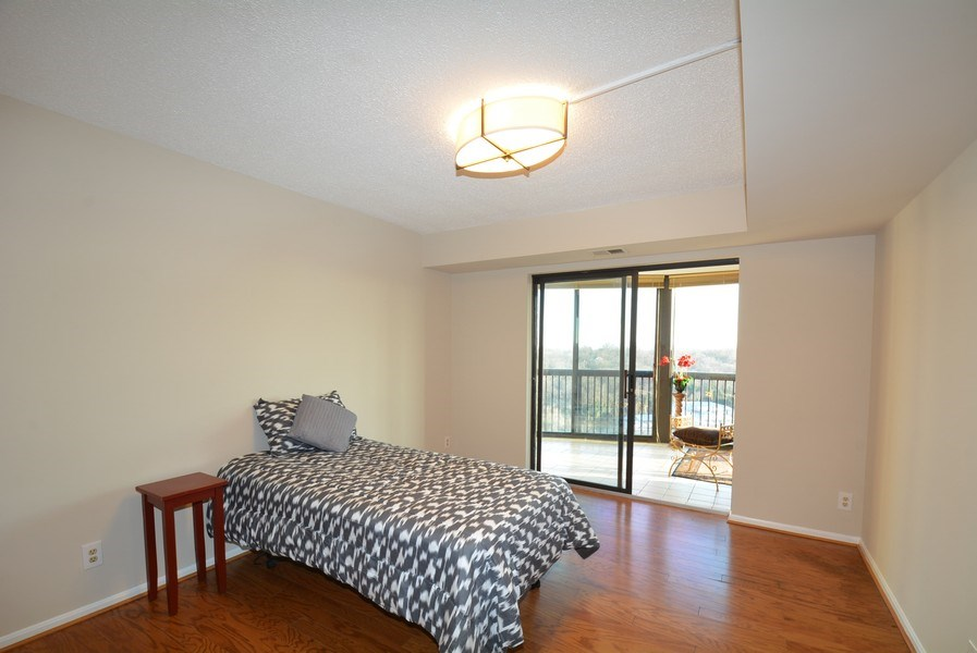 Real Estate Photography - 5904 Mount Eagle Dr, Unit 814, Alexandria, VA, 22303 - Bedroom w/ access to enclosed balcony