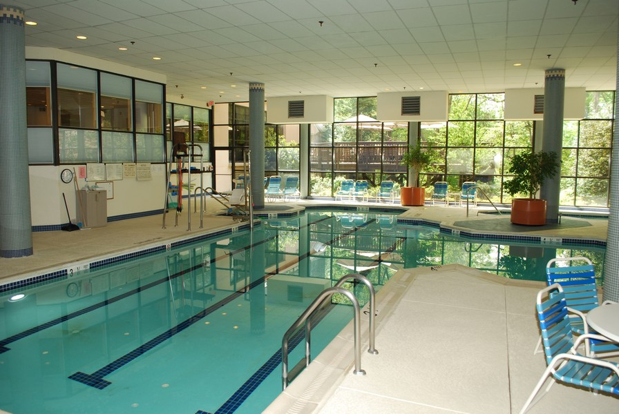 Real Estate Photography - 5904 Mount Eagle Dr, Unit 814, Alexandria, VA, 22303 - Year-round swimming in the pool.