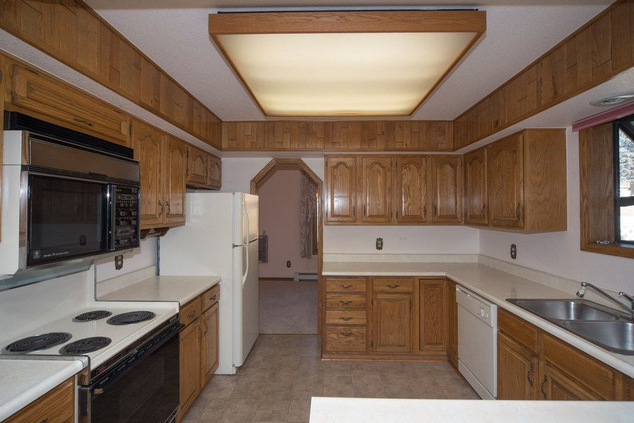 Real Estate Photography - 15 Douglass Dr N, Broomfield, CO, 80020 - Kitchen