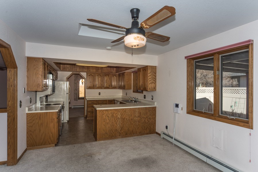Real Estate Photography - 15 Douglass Dr N, Broomfield, CO, 80020 - Kitchen / Dining Room