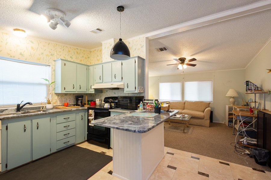 Real Estate Photography - 404 Dolphin Dr, Oldsmar, FL, 34677 - Kitchen