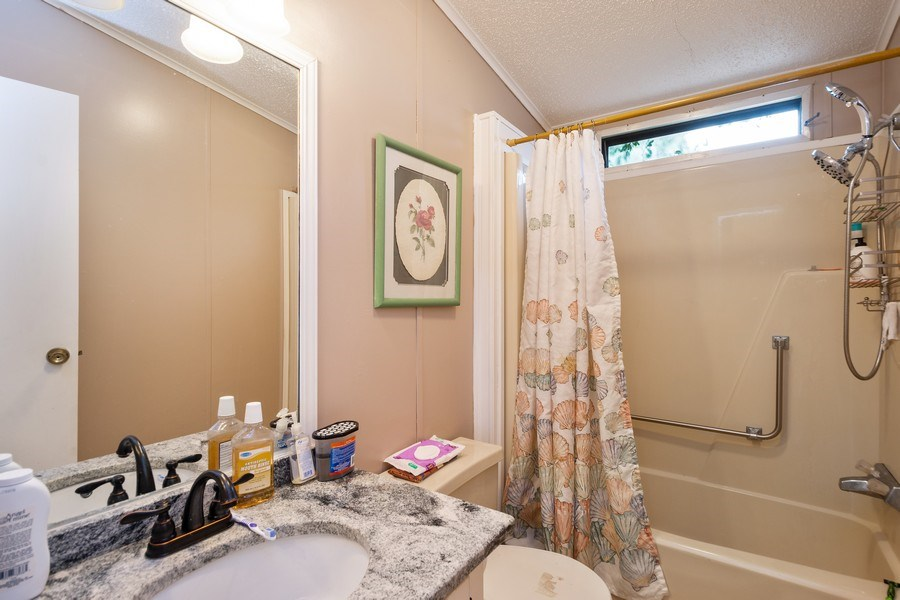 Real Estate Photography - 404 Dolphin Dr, Oldsmar, FL, 34677 - 2nd Bathroom