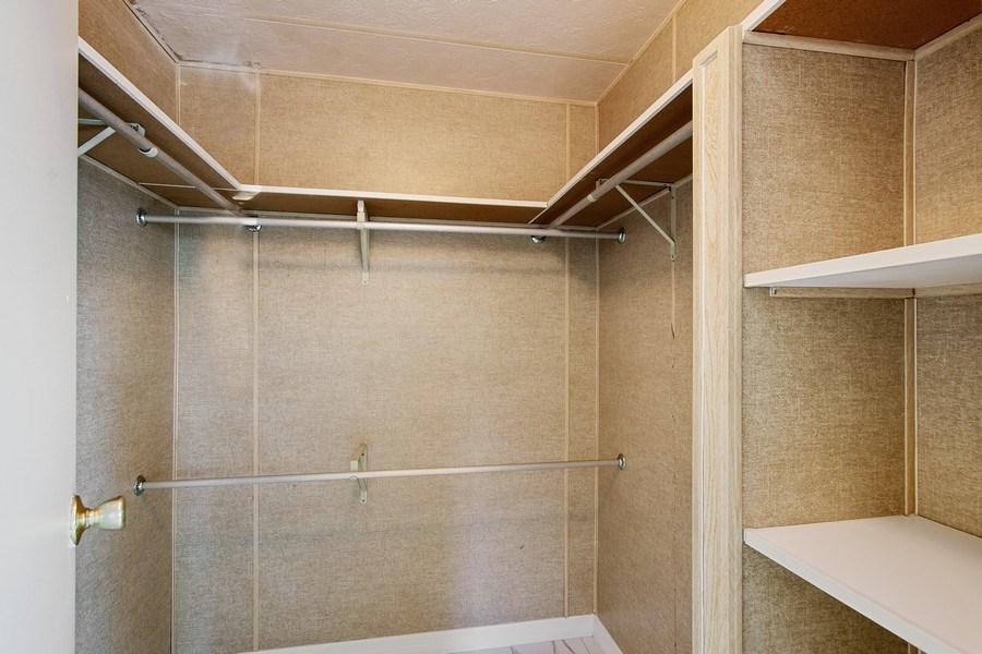 Real Estate Photography - 397 Blue Marlin Dr, Oldsmar, FL, 34677 - Master Bedroom Closet