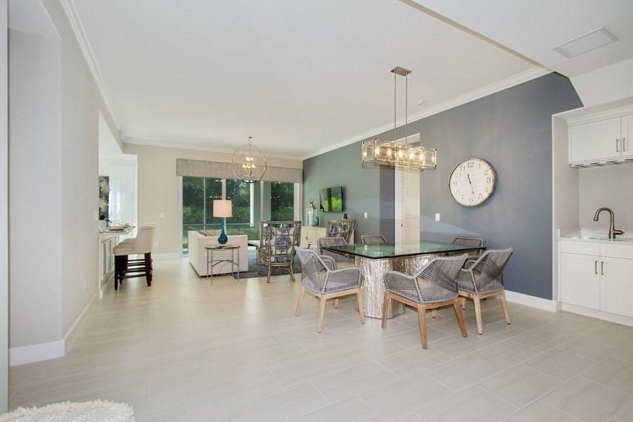 Real Estate Photography - 8031 Signature Club Cir, Unit 16101, Naples, FL, 34113 - Living Room / Dining Room