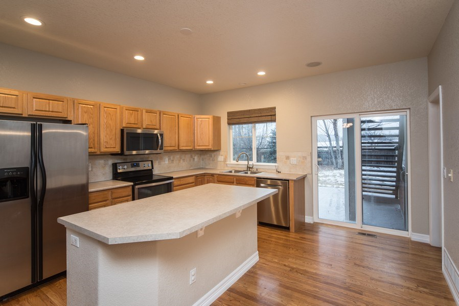 Real Estate Photography - 14061 Blue River Trl, Broomfield, CO, 80023 - Kitchen