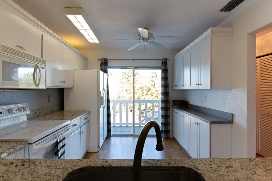 Real Estate Photography - 10441 Waterbird Way, Bradenton, FL, 34209 - Kitchen